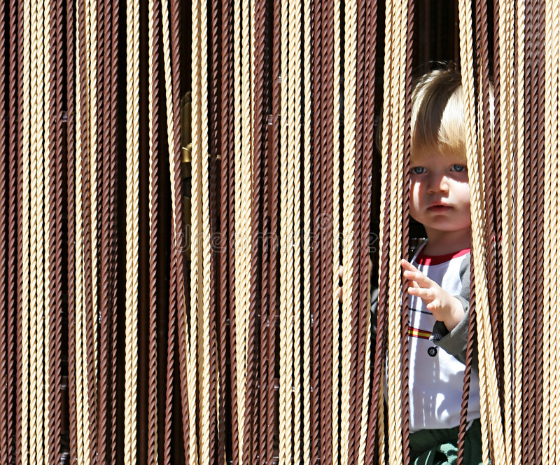 Download Young Boy Looking Out From Behind Curtain Stock Photo - Image: 123724