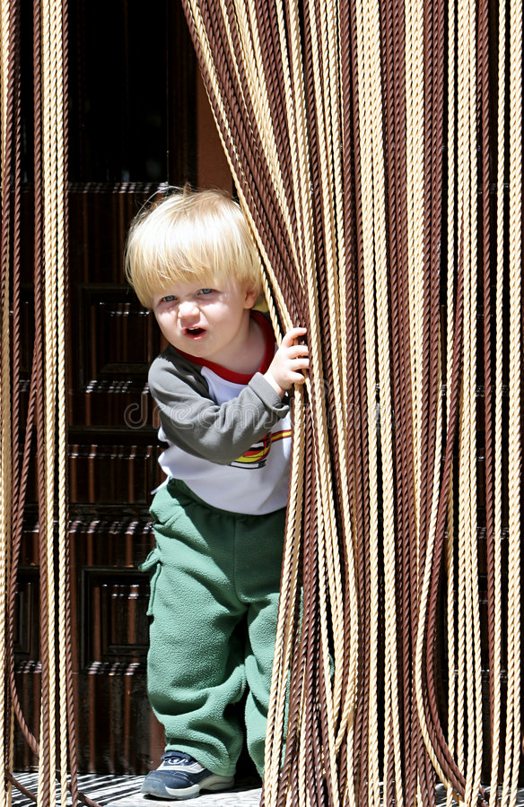 Download Young Boy Looking Out From Behind Curtain Stock Photo - Image: 123798