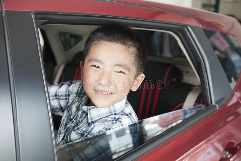 Download Young Boy Looking Out A Car Window Stock Photo - Image: 31693526