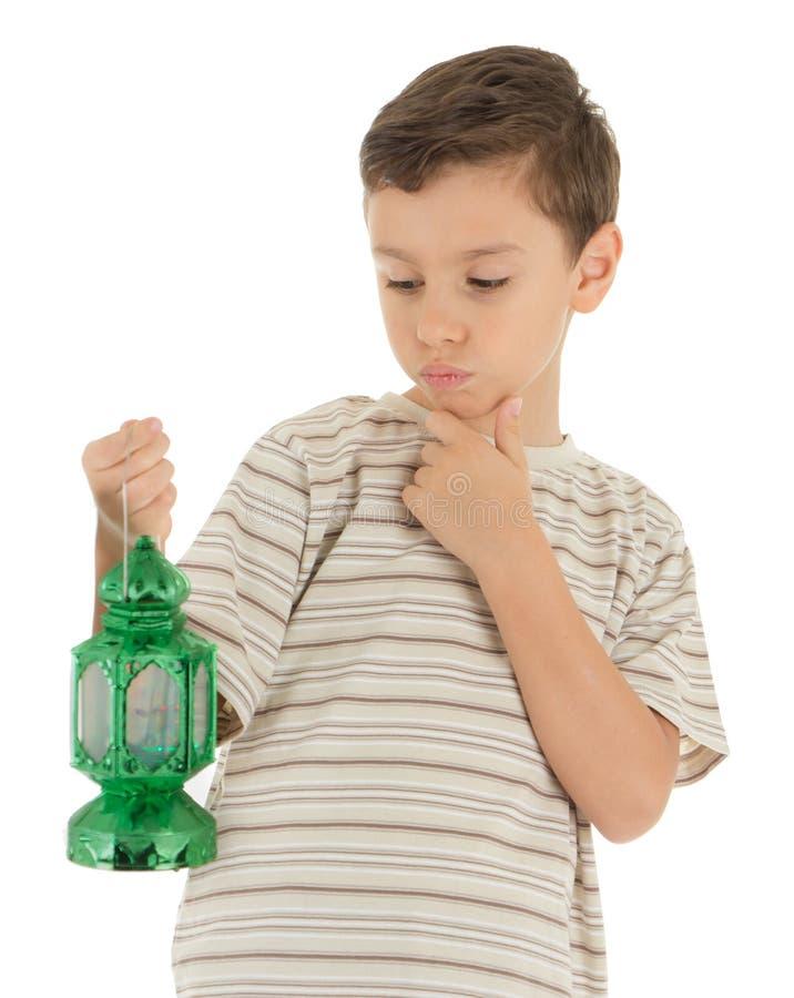Young Boy Looking at Ramadan Lantern royalty free stock photos