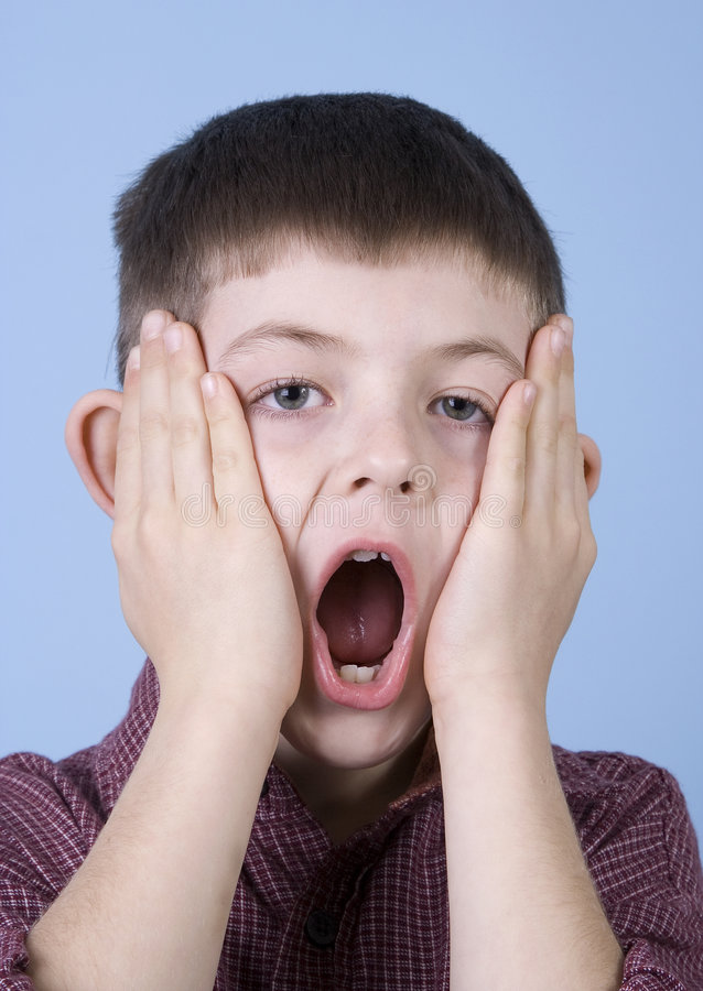 Young Boy Looking Shocked! stock photos