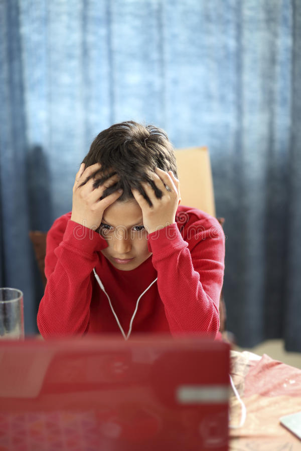 Young boy looks confused stock images