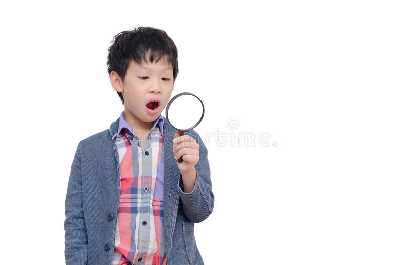 Young boy with magnifying glass stock photos