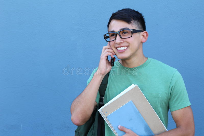 Young boy making fun plans on the phone with space for copy royalty free stock photo