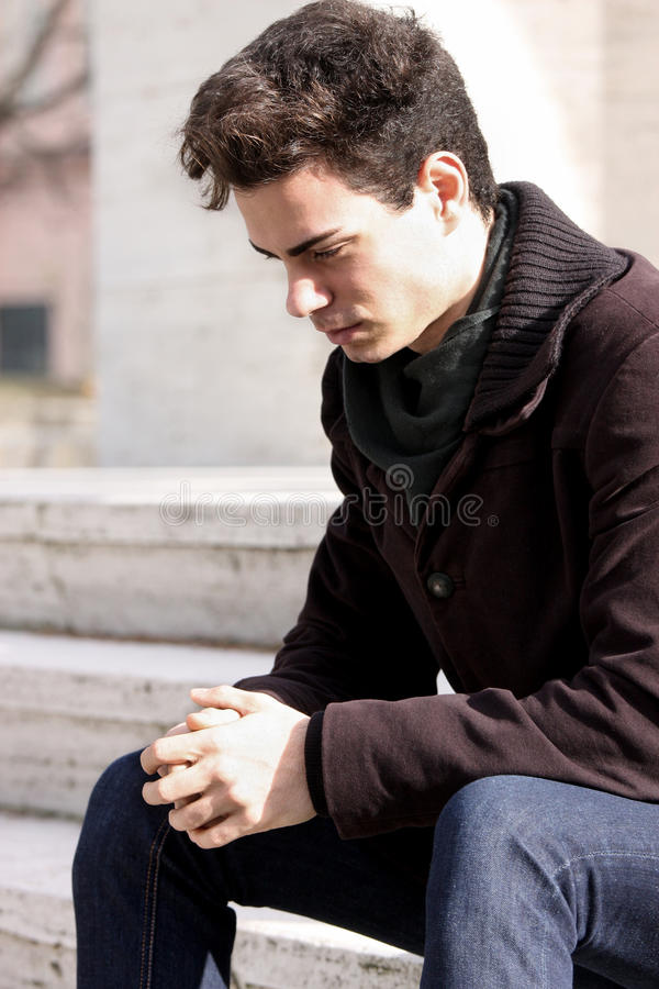 Young boy, sad man thinking about his problems royalty free stock photo