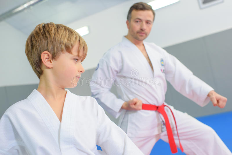 Young boy in martial arts lesson stock photos