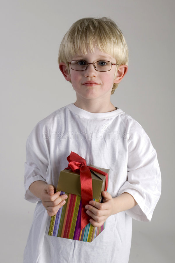 Young boy for mothers day. Young boy with a present for mothersday royalty free stock photography