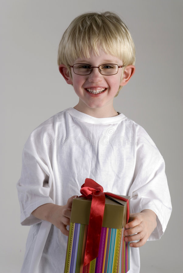 Young boy for mothers day. Young boy with a present for mothersday royalty free stock images