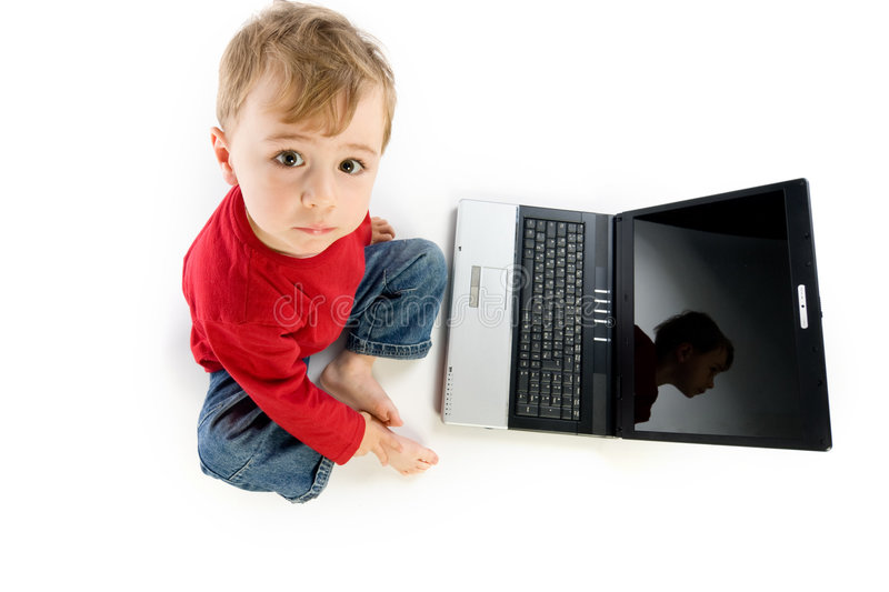 Download Young boy near laptop stock image. Image of contented - 6500779