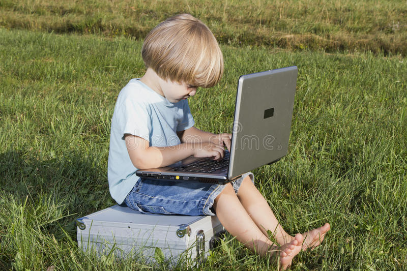 Download Young boy with notebook stock image. Image of sitting - 25469713