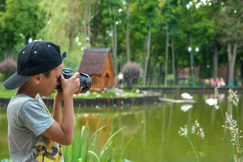 Young boy photographs scenic spots in the park royalty free stock photos
