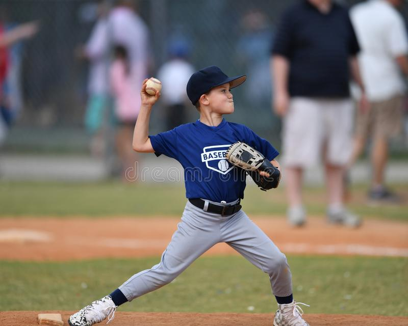 Young boy pitching the ball during a Baseball game stock photo