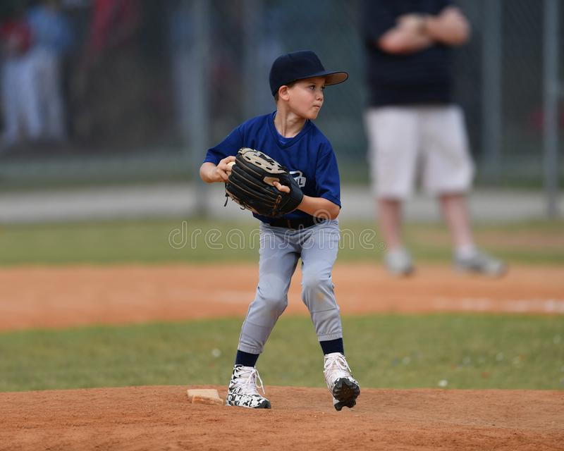 Young boy pitching the ball during a Baseball game stock image