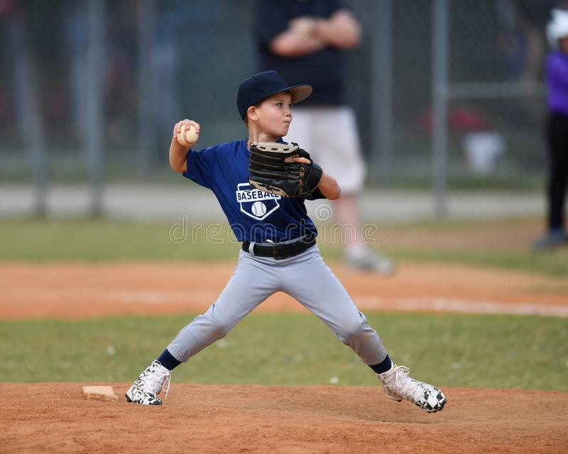 Young boy pitching the ball during a Baseball game stock images