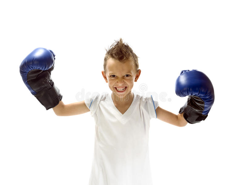 Young boy play boxe with gloves. Young boy play boxe with blue gloves stock photography