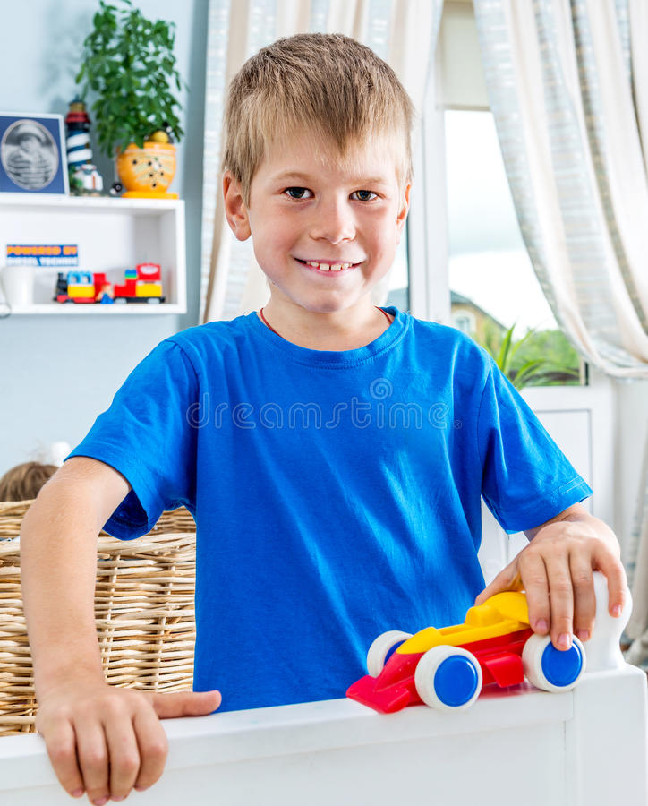 Young boy play with cars royalty free stock photos