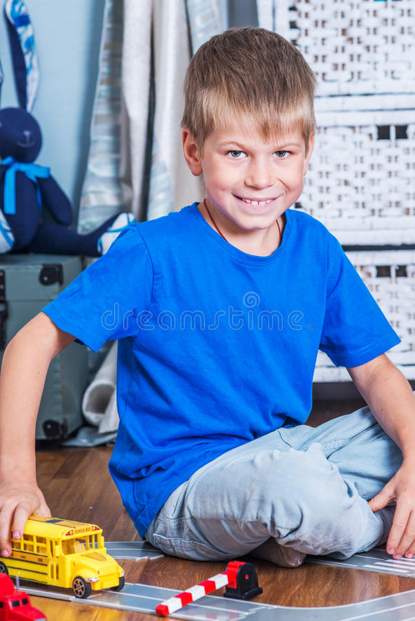Young boy play with cars royalty free stock photo