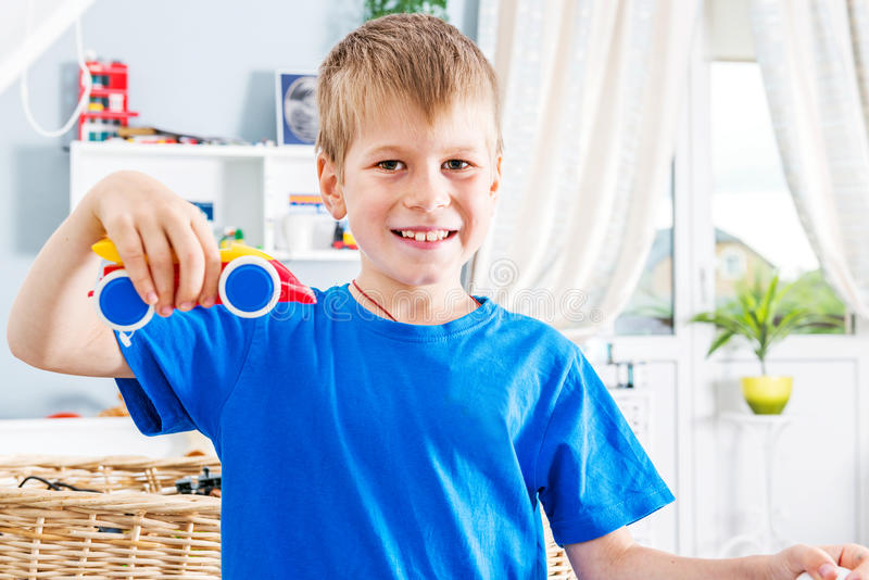 Young boy play with cars stock photos