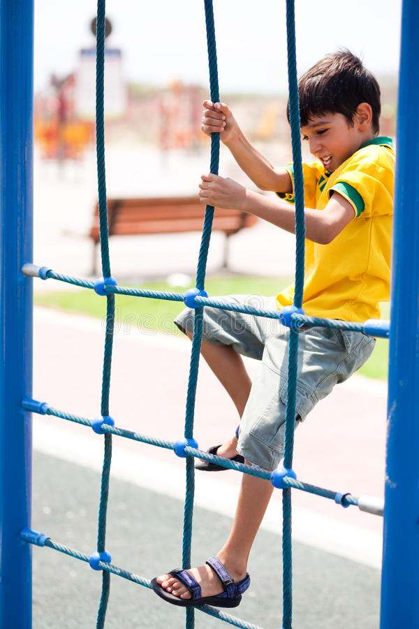 Young boy on play structure stock photos