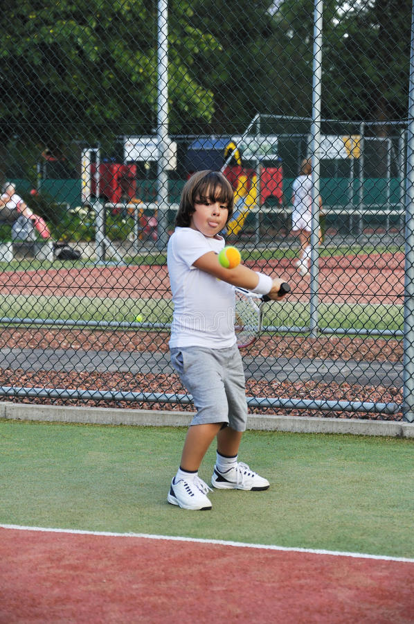 Young Boy Play Tennis Stock Image