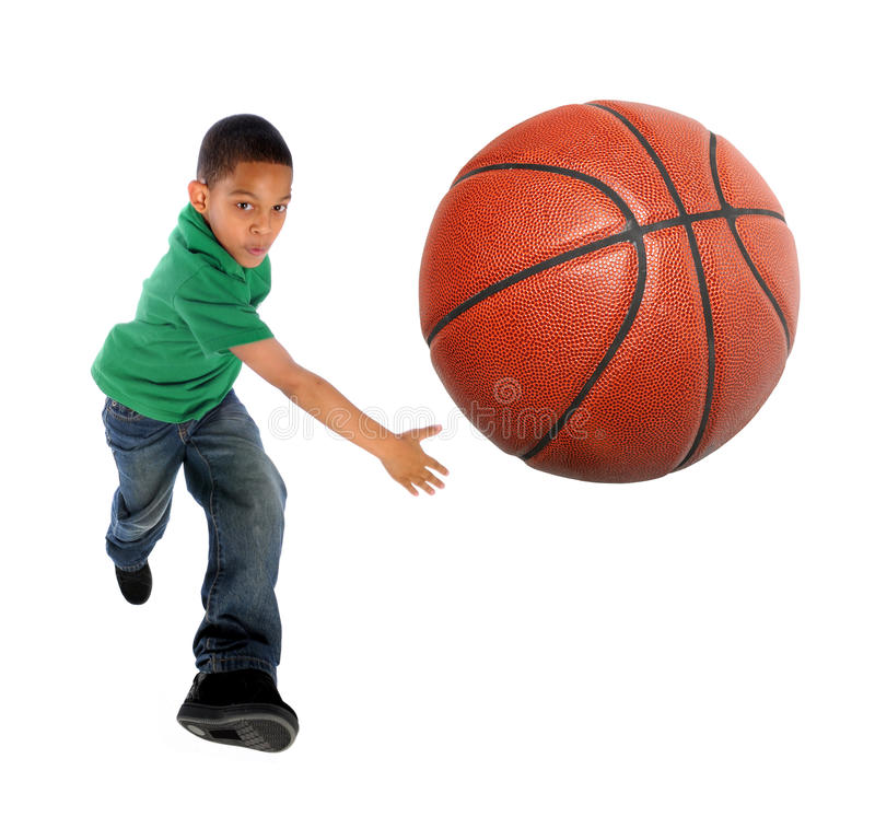 Young Boy Playing Basketball royalty free stock photo