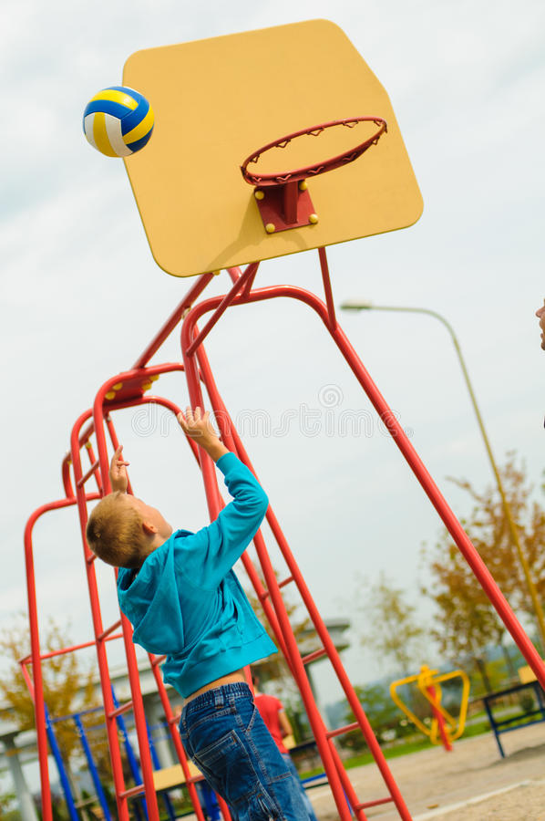 Young boy playing basketball stock images