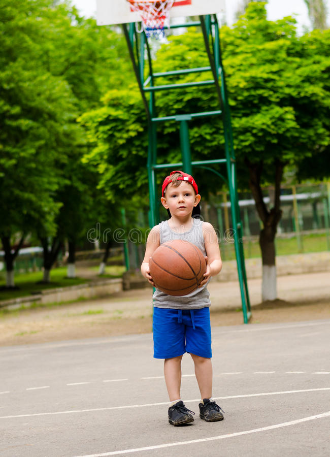 Young boy playing basketball royalty free stock photography