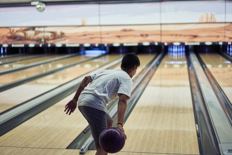 Young boy playing bowling. A Young boy playing bowling royalty free stock photography