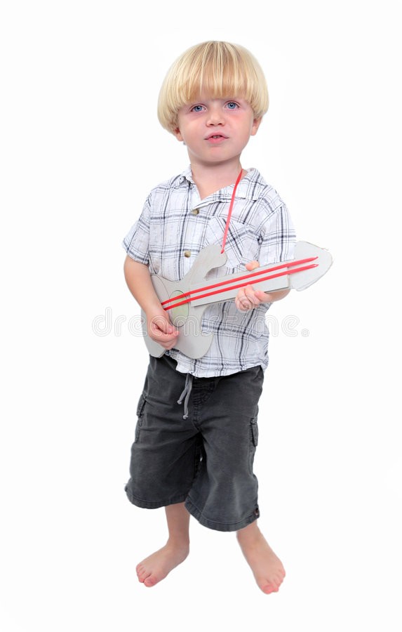 Young boy playing cardboard guitar with white background stock photo