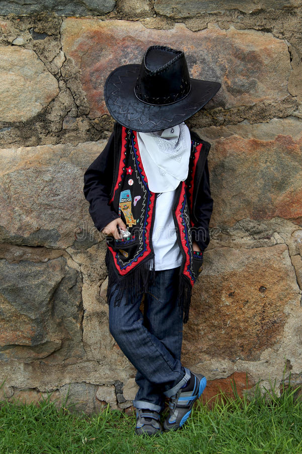 Young boy playing cowboy royalty free stock image