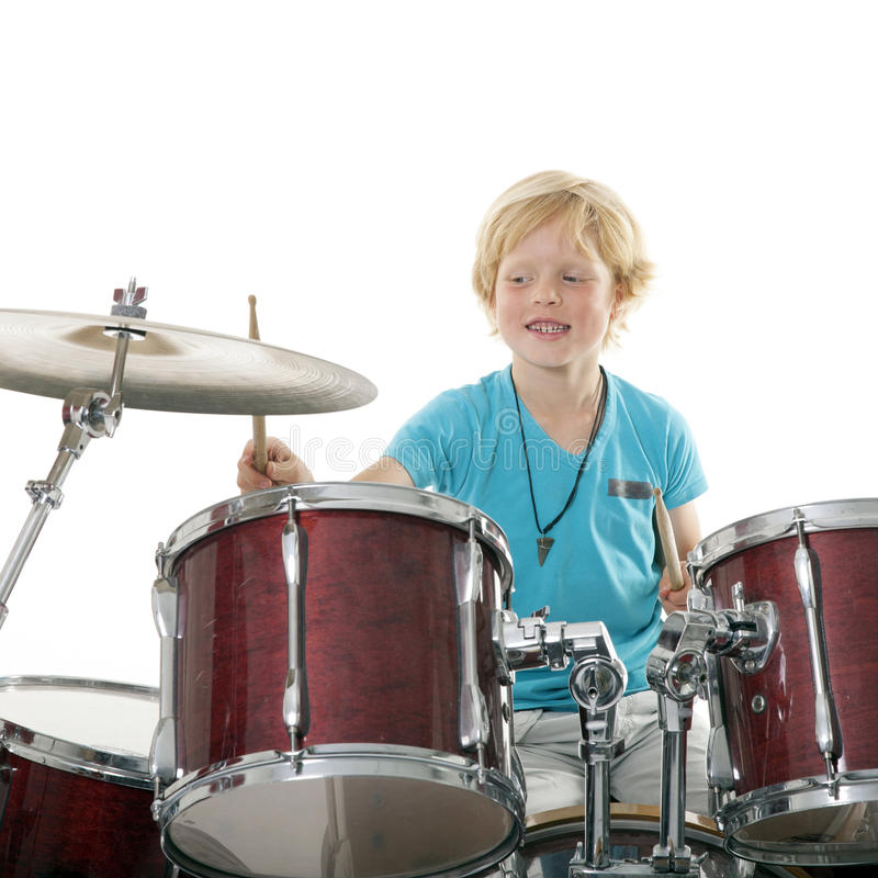 Young boy playing drums royalty free stock images