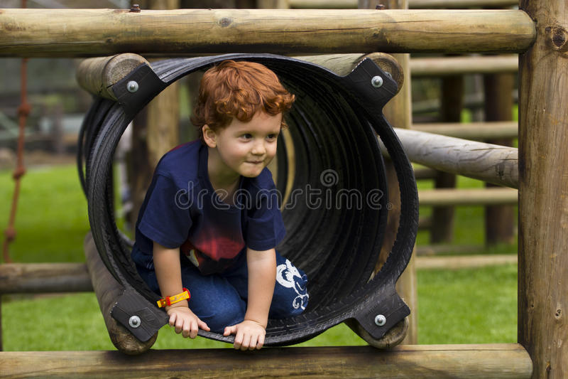 Download Young Boy Playing On A Jungle Gym Stock Image - Image: 29498865