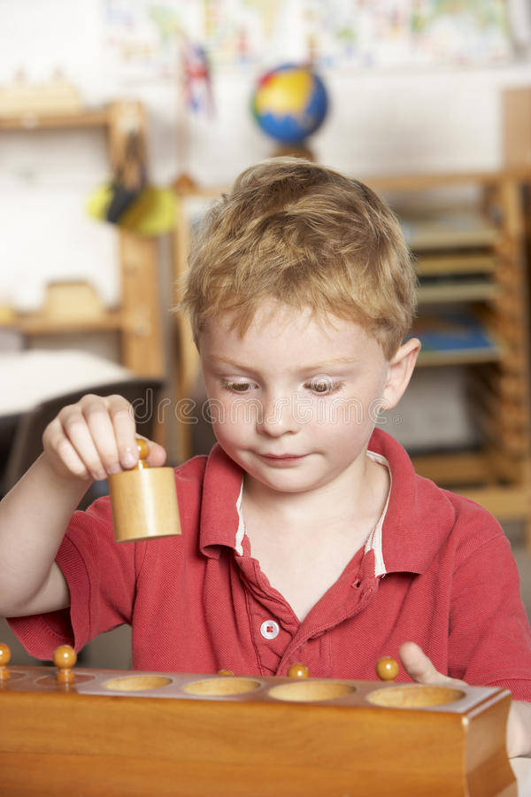 Young Boy Playing at Montessori/Pre-School stock photo
