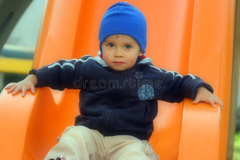 Young boy is playing outdoor royalty free stock photography