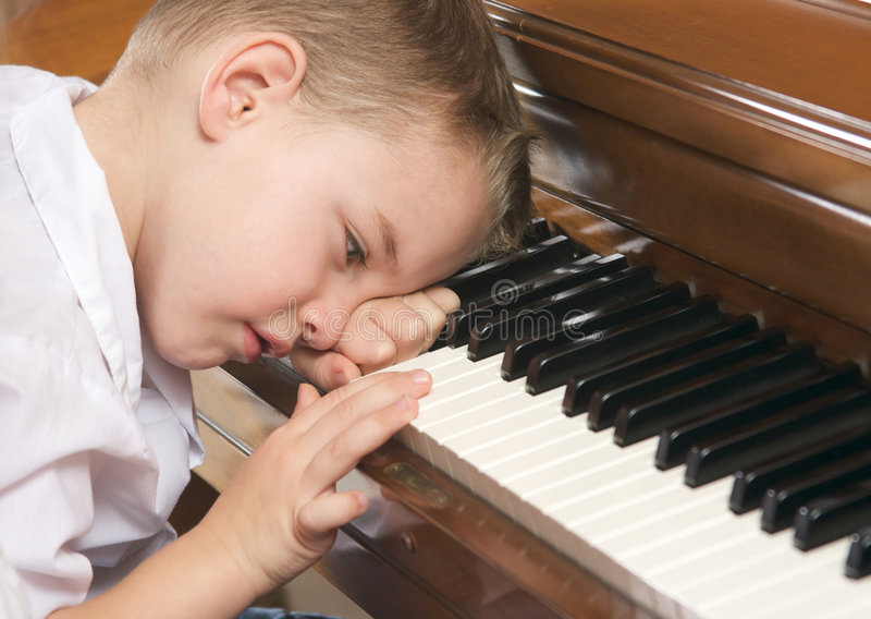 Young Boy Playing The Piano Royalty Free Stock Images
