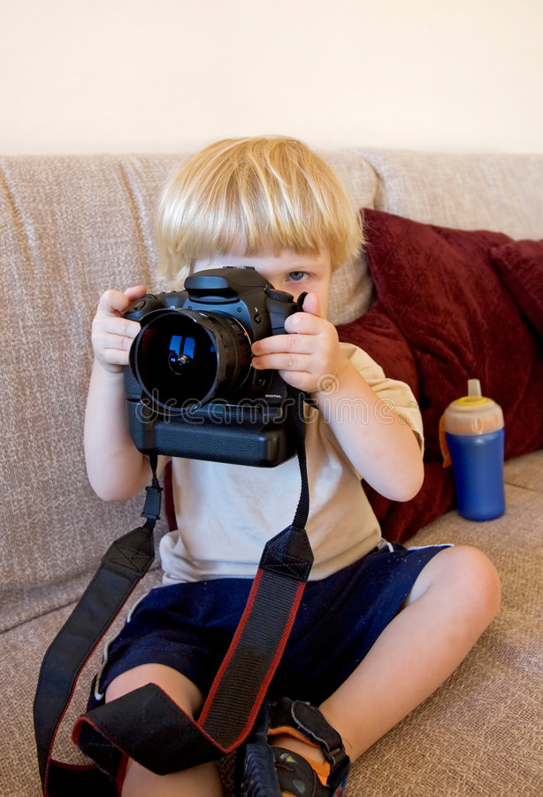 Download Young Boy Playing With SLR Digital Camera Stock Photo - Image: 377596