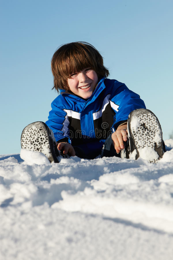 Download Young Boy Playing In Snow On Holiday In Mountains Stock Photography - Image: 24475052