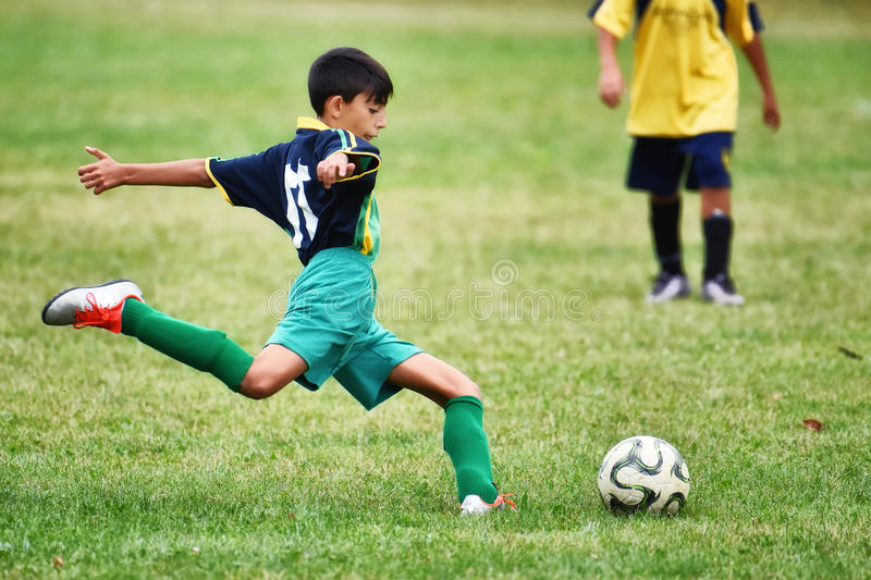 Young boy playing soccer royalty free stock images