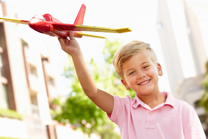 Young Boy playing with toy aeroplane stock photos
