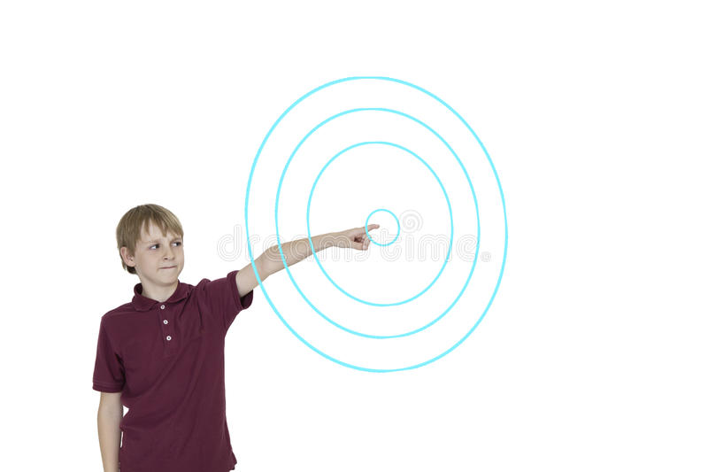 Download Young Boy Pointing To Digitally Designed Concentric Circles Over White Background Stock Photo - Image: 41410270