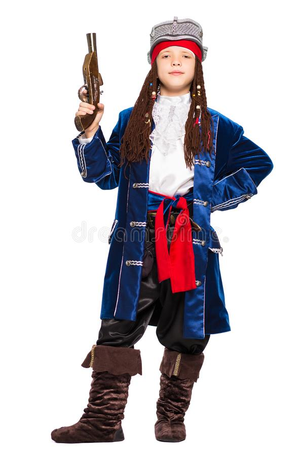 Young boy posing in a suit of pirate royalty free stock images