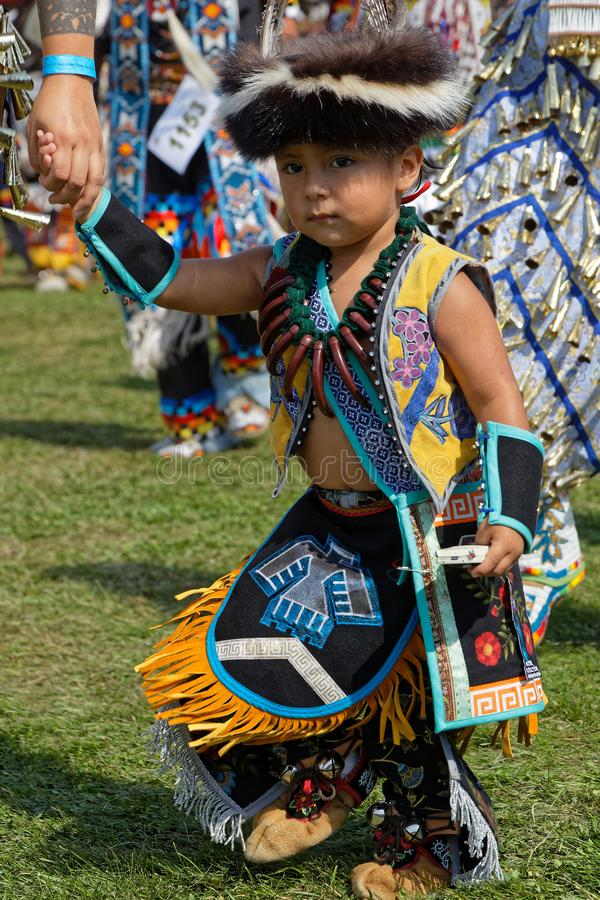 Young boy during Pow Wow grand entry. BISMARK, NORTH DAKOTA, September 8, 2018 : 49th annual United Tribes Pow Wow, one of largest outdoor event, gathers in stock images