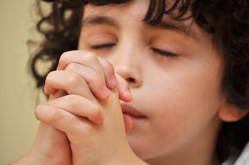 Young Hispanic Child Praying and Worshiping God stock photography