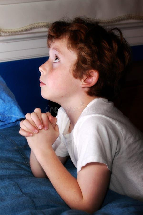 Young boy praying royalty free stock photo