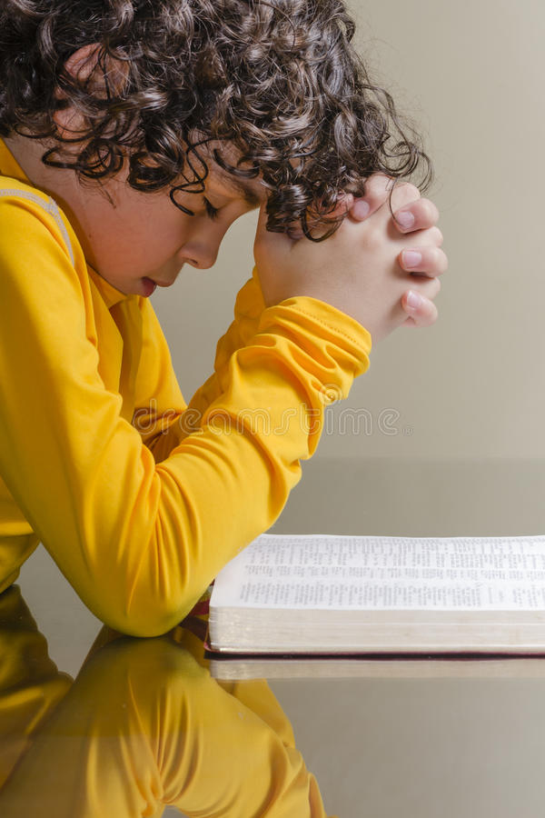 Young Boy Praying royalty free stock photography