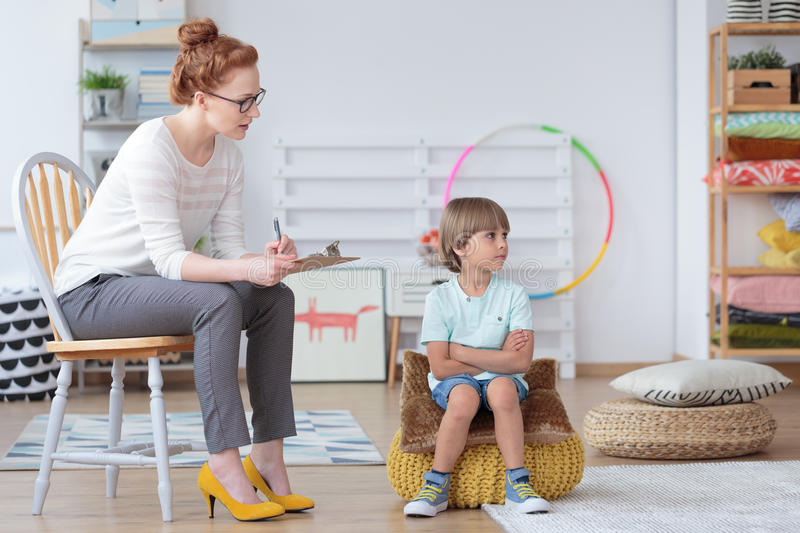 Young boy during psychotherapy session royalty free stock photos