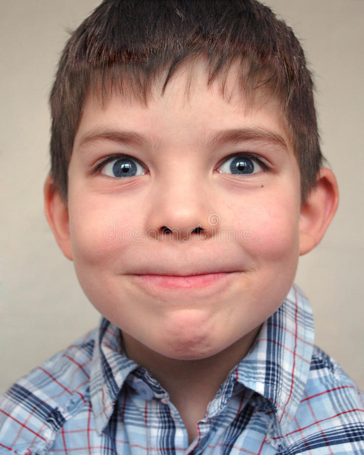 Young boy pulls a face stock image