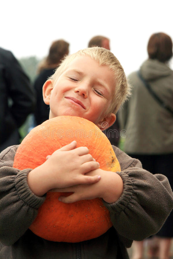 Young boy with pumpkin. stock photography