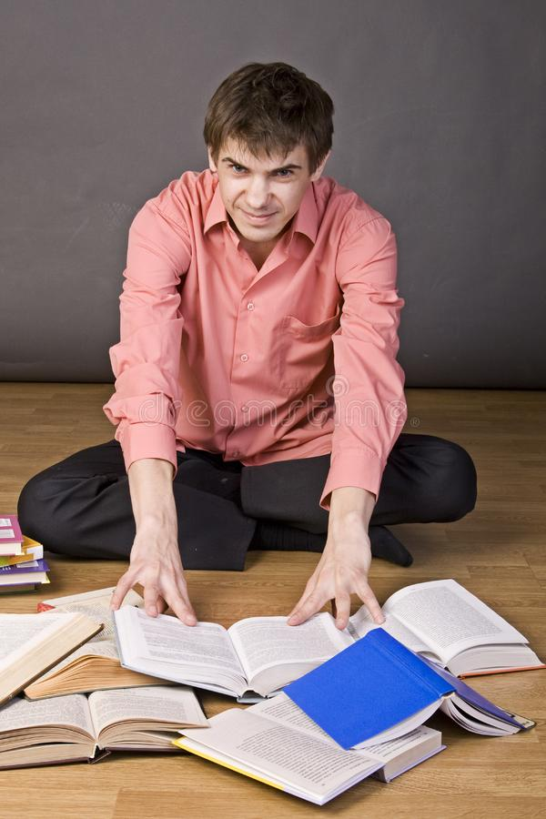 Download Young boy reading a book stock image. Image of shirt - 17202265