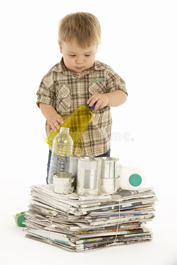 Young Boy Recycling In Studio stock images